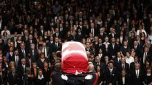 The casket containing Jack Layton is carried away during his state funeral in Toronto. (Chris Wattie/Chris Wattie/Reuters)