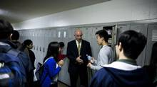 "Dave Derpak, principal of Killarney Secondary School in Vancouver, speaks to students while implementing the ""platooning"" technique at the end of the lunch hour. (Rafal Gerszak for The Globe and Mail)"