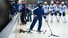 Leafs coach Ron Wilson takes to the ice as the Toronto Maple Leafs held an outdoor practice at Sunnydale Acres Rink in Toronto. (Kevin Van Paassen/Kevin Van Paassen/The Globe and Mail)