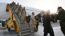 Canadian troops on the tarmac at CFB Trenton after returning from Afghanistan, Jan. 23, 2014. (Lars Hagberg for The Globe and Mail)