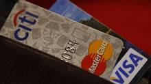 Credit cards are pictured in a wallet. (STELIOS VARIAS/REUTERS)