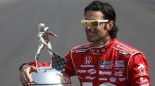 Franchitti poses with the Borg-Warner Trophy after he won his third Indianapolis 500. (JEFF HAYNES/REUTERS)