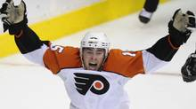 File - Philadelphia Flyers' Joffrey Lupul celebrates his game-winning goal against the Washington Capitals during the overtime period of Game 7 of an NHL playoff hockey series, Tuesday, April 22, 2008, in Washington. On Wednesday Lupul was traded from Anaheim to Toronto in exchange for defenceman Francois Beauchemin . (AP Photo/Nick Wass) (Nick Wass)