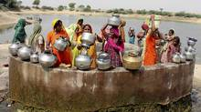 Women gather at a village well to draw drinking water at Kayla village, 65 km west of the Indian city of Ahmedabad, May 5, 2009. (AMIT DAVE/REUTERS/AMIT DAVE/REUTERS)