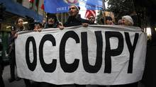 Occupy Wall Street demonstrators protest on the streets of lower Manhattan near the New York Stock Exchange. (MIKE SEGAR/REUTERS)