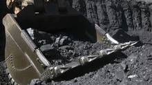 An excavator loads coal at Macarthur Coal's Moorvale mine located about 750km northwest of Brisbane in this undated file handout photograph. Peabody Energy and Arcelor Mittal have offered to buy Australian coal miner Macarthur Coal valuing the firm at A$4.7 billion ($5.05 billion) or at a 40 percent premium to July 11, 2011 Monday's close. (HO/REUTERS)