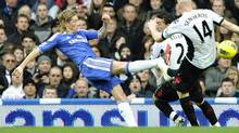 Chelsea's Fernando Torres (L) challenges Fulham's Stephen Kelly (C) and Philippe Senderos during their English Premier League soccer match at Stamford Bridge in London December 26, 2011. (DYLAN MARTINEZ/REUTERS)