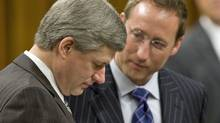 Prime Minister Stephen Harper goes over documents with Defence minister Peter MacKay in the House of Commonson Nov. 18, 2008. (Tom Hanson/The Canadian Press)