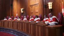 Canada's Supreme Court Justices in Ottawa on Oct. 6. The court has ordered a failed Sri Lankan asylum claimant be given another chance to apply to stay in Canada on humanitarian and compassionate grounds. (CHRIS WATTIE/REUTERS)