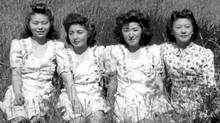 Four young women, originally sent to internment camps in the Slocan Valley during the Second World War, take a break while working on a local family farm in 1946. (Handout/Handout)