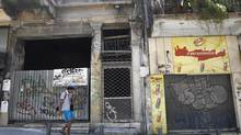 A man walks in front of a row of closed shops in central Athens June 24, 2011. (JOHN KOLESIDIS/REUTERS)