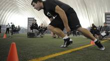 McMaster offensive lineman Matthew Sewell runs drills at the CFL Combine at Varsity Stadium in Toronto on Sunday. (J.P. MOCZULSKI/THE GLOBE AND MAIL)