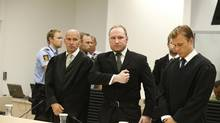 Norwegian mass killer Anders Behring Breivik gestures as he leaves the courtroom after the Oslo Court delivered the verdict of his trial in Oslo Courthouse August 24, 2012. (NTB SCANPIX/REUTERS)