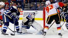 Sam Bennett #93 of the Calgary Flames slides a wrap around shot past Joonas Korpisalo #70 of the Columbus Blue Jackets during the third period on January 21, 2016 at Nationwide Arena in Columbus, Ohio. Calgary defeated Columbus 4-2. (Kirk Irwin/Getty Images)