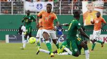 Ivory Coast's Didier Drogba (11) controls the ball against Senegal's players during their 2014 World Cup qualifying soccer match in Abidjan October 12, 2013. (THIERRY GOUEGNON/REUTERS)