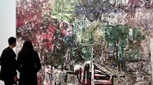 """A couple admire the 1970 painting """" Homage to Grey Owl"""" by Canadian artist Jean-Paul Riopelle at the Montreal Museum of Fine Arts, March 13, 2002. The Department of Foreign Affairs is poised to sell off paintings in its collection by some of the most famous and sought after artists in Canadian history, including Riopelle, Borduas and Kurelek, to make some extra cash. (SHAUN BEST/REUTERS/SHAUN BEST/REUTERS)"""