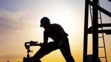 Oil worker silhouette (zorandimzr/Getty Images/iStockphoto)