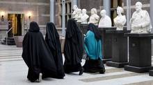 Women wearing niqab visit the Senate on November 23, 2016 in the Hague, the Netherlands. Dutch MPs on November 29, 2016 voted by a large majority to approve a ban on wearing the Islamic full-face burqa in some public places such as schools and hospitals. The legislation must now go before the Senate for approval before becoming law. It follows similar bans imposed in France and Belgium. (AFP/Getty Images)