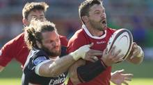 Canada's James Pritchard (right) is tackled by Todd Clever of the United States during second half Rugby World Cup Qualifying action in Toronto on Saturday August 24, 2013. (CHRIS YOUNG/THE CANADIAN PRESS)