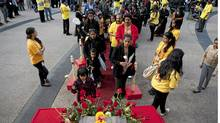 Members of Toronto's Tamil community lay down flowers in respect of those killed in the civil war in Sri Lanka. The community gathered for the third annual War Crimes Day on Friday, May 18, 2012 (Matthew Sherwood for The Globe and Mail/Matthew Sherwood for The Globe and Mail)