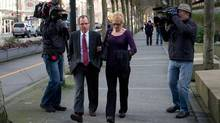 Karen Briker, right, arrives at B.C. Supreme Court to testify at the Queen of the North passenger ferry sinking trial in Vancouver on March 4, 2013. (Darryl Dyck/The Canadian Press)