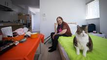 Zona Hudson, 79, sits with her cat Misty at her home at the Jubilee House tower on Richards Street in downtown Vancouver. (DARRYL DYCK/The Globe and Mail)