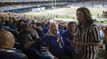 Toronto Mayor Rob Ford and his driver Jerry Agyemang, to Mr. Ford's left, attend the Buffalo Bills versus Atlanta Falcons NFL game at the Rogers Centre on Dec. 1, 2013. (PHILIP CHEUNG FOR THE GLOBE AND MAIL)