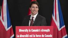 Prime Minister Justin Trudeau steps up to the podium to deliver a speech at Canada House in London, England, on Wednesday, Nov. 25, 2015. (Adrian Wyld/THE CANADIAN PRESS)