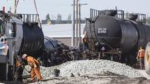 Workers prepare to empty the contents and then right seven railway cars that derailed last night in Calgary, Alberta on Wednesday, September 11, 2013. (Chris Bolin/Chris Bolin)