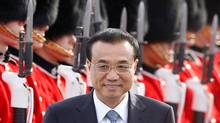 Chinese Premier Li Keqiang walks to his limousine upon his arrival in Ottawa on Wednesday. (CHRIS WATTIE/REUTERS)