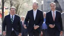 Canada's Finance Minister Jim Flaherty (L) walks with incoming Bank of Canada governor Stephen Poloz (C) and outgoing Governor Mark Carney to a news conference announcing Mr. Poloz's appointment in Ottawa. (CHRIS WATTIE/REUTERS)