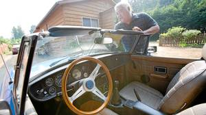 Children's books author Michael Kusugak polishes his favorite MG sports car in Qualicum Beach on Vancouver Island where he just relocated with his wife who recently retired.