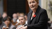 Quebec's Premier Pauline Marois speaks during her inaugural speech at the National Assembly in Quebec City on October 31, 2012. She was wearing a Remembrance Day poppy with a fleur-de-lis pin - a gesture that provoked angry reactions from a veterans' group. (JACQUES BOISSINOT/REUTERS)