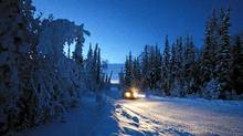 A Ford F150 drives the winter road from Norman Wells to Fort Good Hope, in the early dawn--at about 10:30 in the morning. The road is barely a road at all, in use only during the coldest months of the year. It cuts through otherwise untouched boreal forest, just south of the Arctic Circle, and roughly marks the route of the proposed Mackenzie Valley natural gas pipeline. (John Lehmann/The Globe and Mail/John Lehmann/The Globe and Mail)