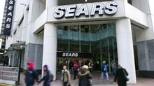 People walk past the main Sears store in downtown Vancouver. (ANDY CLARK/ANDY CLARK/REUTERS)