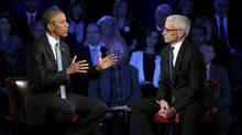U.S. President Barack Obama participates in a live town hall event on reducing gun violence hosted by CNN'sAnderson Cooper (R) at George Mason University in Fairfax, Virginia January 7, 2016. (KEVIN LAMARQUE/REUTERS)