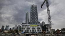 Construction work being done on a condominium site at Bathurst Street and Fork York Blvd. in Toronto on May 29, 2012. (Deborah Baic/The Globe and Mail)