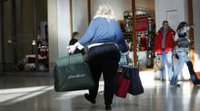 A woman shops at Yorkdale Mall in Toronto. (Charla Jones/The Globe and Mail/Charla Jones/The Globe and Mail)