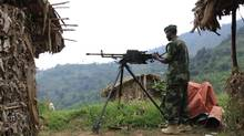 A M23 rebel fighter mans a machine gun at their defence position in Karambi, eastern Democratic Republic of Congo, near the border with Uganda, on July 12, 2012. (JAMES AKENA/REUTERS)