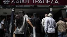 A crowd waits for a branch of Laiki Bank to open in Nicosia, Cyprus, on March 28, 2013.