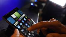 BlackBerry introduced a new program called Blend with the launch of the Passport, which allows users to display their smartphone on their computer screen. (AARON HARRIS/REUTERS)