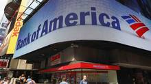 Tourists walk past a Bank of America banking center in Times Square in New York in this file photo taken June 22, 2012. (BRENDAN McDERMID/Reuters)