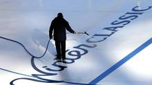 A worker sprays water on the Winter Classic logo of the outdoor rink for the 2012 NHL Winter Classic game at the ballpark in Philadelphia, Pennsylvania, December 29, 2011. (TIM SHAFFER/REUTERS)