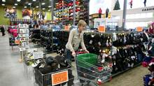 An employee pushes a shopping cart at SAIL in Ottawa. (Dave Chan For The Globe and Mail)