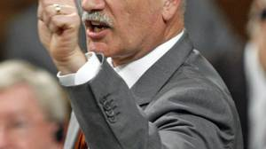 NDP Leader Jack Layton attacks the Harper government during Question Period in the House of Commons on June 11, 2009.