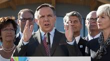 Coalition Avenir Quebec leader Francois Legault speaks to reporters during a campaign stop Friday August 24, 2012 in Quebec City. Quebecers will vote in a general election on Sept. 4. (Clement Allard/The Canadian Press)