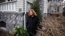 Elizabeth Seaton is pictured outside of her home that has a separate infilled home on the property in Vancouver, on March 1, 2017. The city is talking about a new approach in single-family neighbourhoods that would encourage more of the kind of infill housing that exists on Seaton's property. (BEN NELMS/The Globe and Mail)