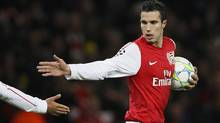Soccer star and Arsenal captain Robin van Persie was sold to Manchester United six weeks after stating on his website that he and management 'disagree on the way Arsenal FC should move forward.' (Kirsty Wigglesworth/AP)