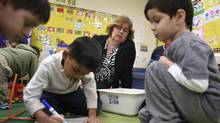 Sandy McCuaig, a full kindergarten class teacher with some of her students at Floradale Public School in Mississauga, Ont. on April 8 2014. (Fred Lum/The Globe and Mail)
