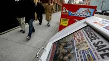 People walk past a Toronto Sun newspaper box (Deborah Baic/The Globe and Mail)